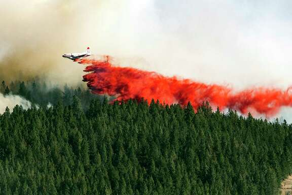 Fire retardant drops last year on the north side of Beacon Hill in Spokane, Wash.  In what officials say could become a template for Western states, the U.S. Forest Service and Idaho have forged agreements leading to more logging on federal land.