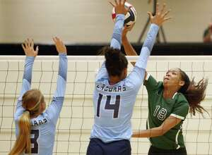 ReaganÕs Kyla Waiters spikes the ball past JohnsonÕs Kaylyn Winkler from the District 26-6A high school volleyball match between Reagan and Johnson on Friday,Sept. 22, 2017