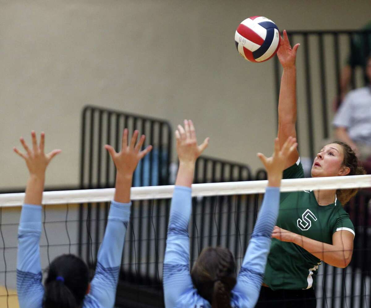 Reagan?•s Camryn Ennis spikes a ball against Johnson from the District 26-6A high school volleyball match between Reagan and Johnson on Friday,Sept. 22, 2017