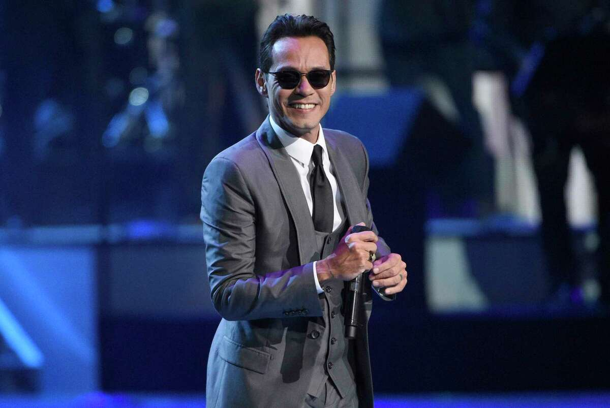 FILE - In this Nov. 17, 2016 file photo, Marc Anthony performs a medley at the 17th annual Latin Grammy Awards at the T-Mobile Arena in Las Vegas. Anthony is pleading for help for Puerto Rico, which has been devastated after being pummeled by Hurricanes Maria and Irma. (Photo by Chris Pizzello/Invision/AP) ORG XMIT: NY107