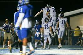 The Boerne Greyhounds celebrate a 17-yard touchdown by Douglas Hodo during the second half of their non-district football game with Boerne Somerset at Bulldog Stadium on Friday, Sept. 22, 2017. Boerne beat Somerset 35-30.  MARVIN PFEIFFER / mpfeiffer@express-news.net