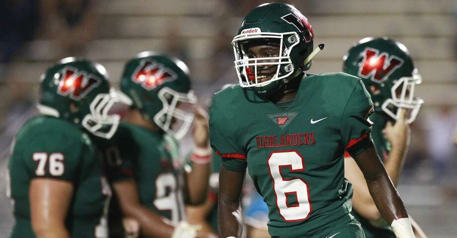 The Woodlands wide receiver Kesean Carter (6) smiles after catching 20-yard touchdown pass from quarterback Quinn Binney during the third quarter of a non-district high school football game at Woodforest Bank Stadium, Friday, Sept. 22, 2017, in Shenandoah. Photo: Jason Fochtman/Houston Chronicle