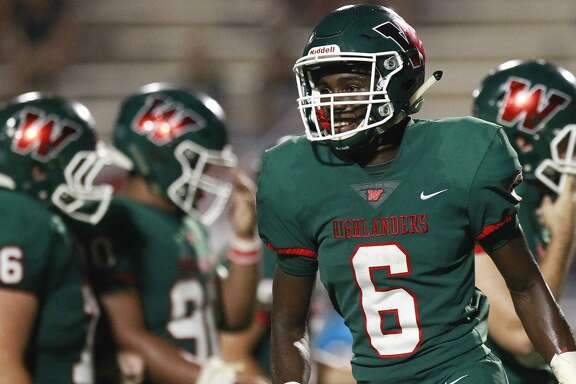The Woodlands wide receiver Kesean Carter (6) smiles after catching 20-yard touchdown pass from quarterback Quinn Binney during the third quarter of a non-district high school football game at Woodforest Bank Stadium, Friday, Sept. 22, 2017, in Shenandoah.