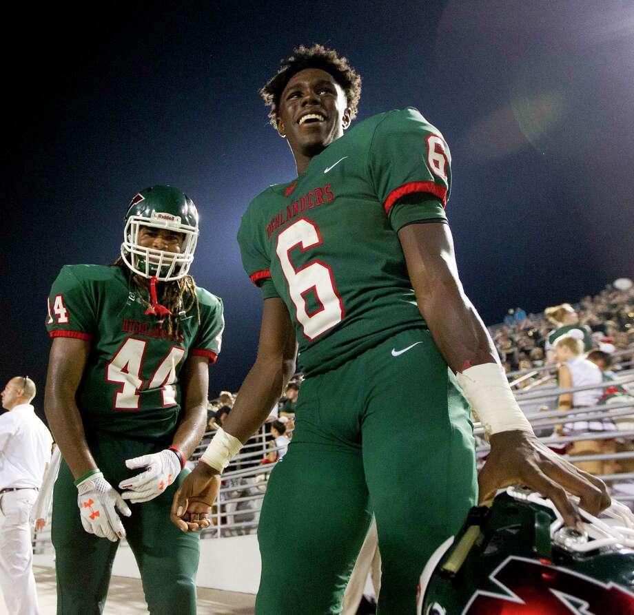 The Woodlands wide receiver Kesean Carter (6) shares a laugh with running back Jacoby Clarke (44) after scoring five touchdowns in the Highlanders' 52-12 win over George Ranch during a non-district high school football game at Woodforest Bank Stadium, Friday, Sept. 22, 2017, in Shenandoah. Photo: Jason Fochtman, Staff Photographer / © 2017 Houston Chronicle