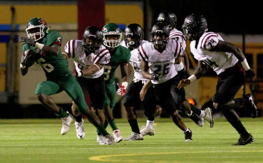The Woodlands wide receiver Kesean Carter (6) breaks a tackle by George Ranch linebacker Jahleel Thomas (40) as he returns a kickoff for a 75-yard touchdown during the third quarter of a non-district high school football game at Woodforest Bank Stadium, Friday, Sept. 22, 2017, in Shenandoah. Photo: Jason Fochtman, Staff Photographer / © 2017 Houston Chronicle