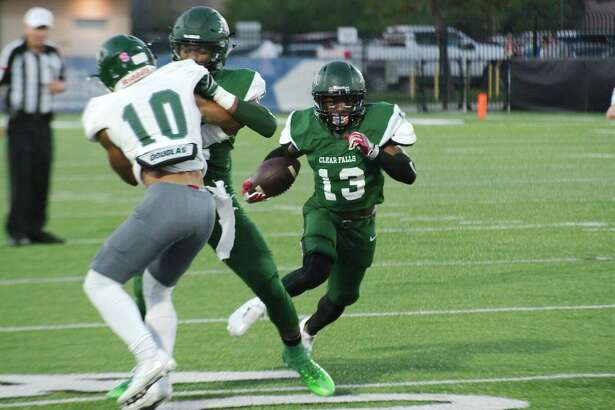 Clear Falls' Jordan Humphrey (13) finds a hole in the Spring defense Friday Sep. 22 at CCISD Veterans Memorial Stadium.