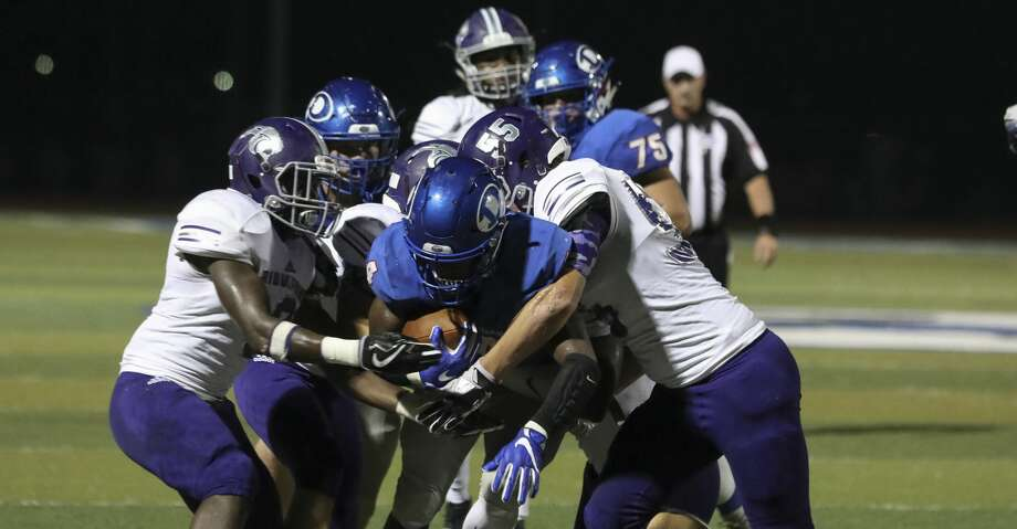 Dickinson's running back Myles Lewis is tackled by several Ridge Point players during the second quarter of the game at Sam Vitanza Stadium Friday, Sept. 22, 2017, in Dickinson. ( Yi-Chin Lee / Houston Chronicle ) Photo: Yi-Chin Lee/Houston Chronicle