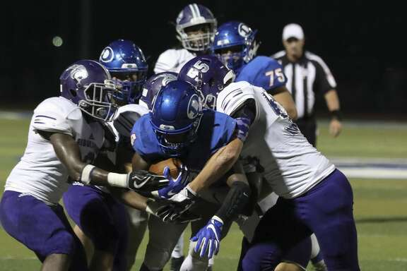 Dickinson's running back Myles Lewis is tackled by several Ridge Point players during the second quarter of the game at Sam Vitanza Stadium Friday, Sept. 22, 2017, in Dickinson. ( Yi-Chin Lee / Houston Chronicle )