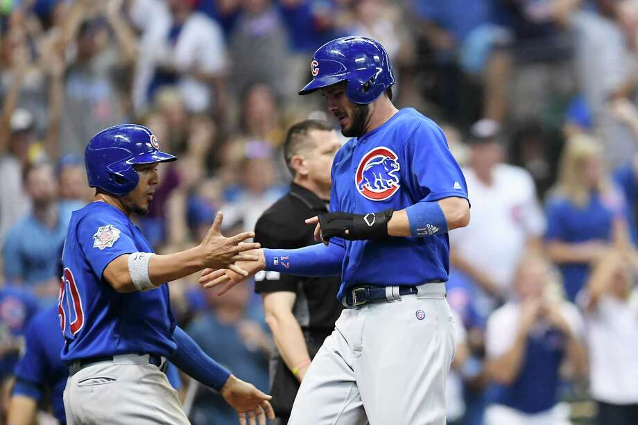 MILWAUKEE, WI - SEPTEMBER 22:  Kris Bryant #17 is congratulated by Jon Jay #30 of the Chicago Cubs after they both scored during the fifth inning of a game against the Milwaukee Brewers at Miller Park on September 22, 2017 in Milwaukee, Wisconsin.  (Photo by Stacy Revere/Getty Images) ORG XMIT: 700012566 Photo: Stacy Revere / 2017 Getty Images