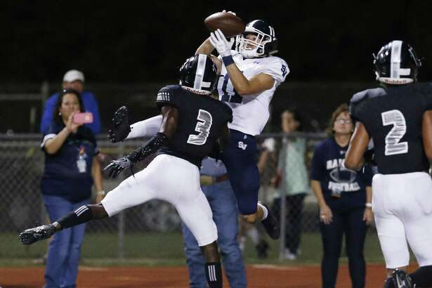 Smithonson Valley's Ricky Rios (11) hauls down a pass from quarterback Levi Williams against Steele's JayVeon Cardwell (03) to take the lead into halftime with 18 seconds left in the first half in high school football at Lenhoff Stadium on Friday, Sept. 22, 2017. (Kin Man Hui/San Antonio Express-News)