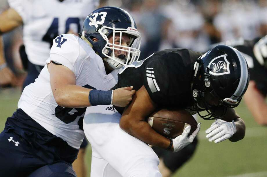 Steele's Brenden Brady, shown in this file photo fighting a tackle attempt by Smithson Valley's Will Gibbens on Sept. 22, rushed for 247 yards and three touchdowns on 21 carries in the Knights' 31-14 victory over Wagner in Week 10. Photo: Kin Man Hui /San Antonio Express-News / ©2017 San Antonio Express-News