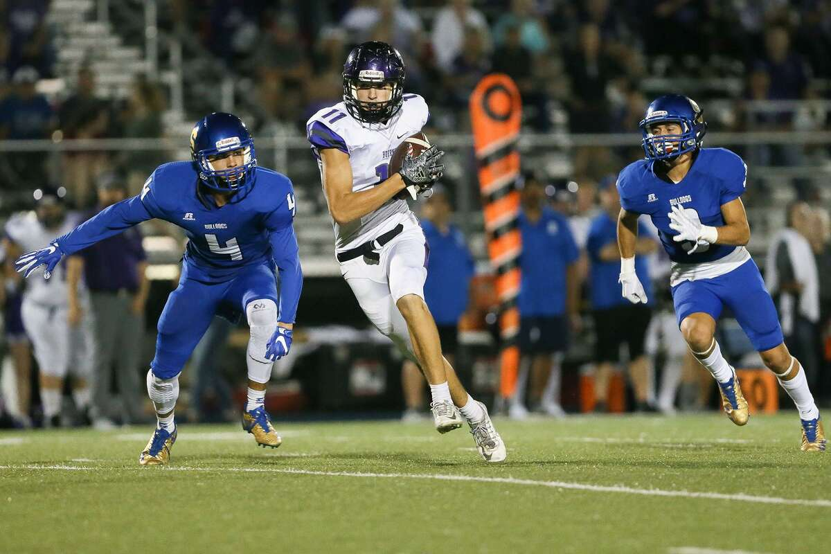 Boerne's Paul Amick (center) hauls in a 74-yard touchdown pass between Somerset's Devon Goff (left) and Tristan Contraras during the second half of their non-district football game with Boerne Somerset at Bulldog Stadium on Friday, Sept. 22, 2017. Boerne came back from a 21-0 first quarter deficit to beat Somerset 35-30.