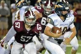 Averill Park quarterback #10 Nick Ferlito runs the ball against the Burnt Hills defense during Friday night's game Sept. 22, 2017 in Burnt Hills, NY.  (John Carl D'Annibale / Times Union)