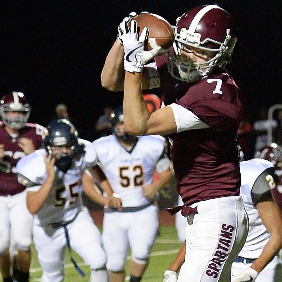 Burnt Hills' #7 Mike Levan completes a Darien Lapietro pass during Friday night's game against Averill Park Sept. 22, 2017 in Burnt Hills, NY. (John Carl D'Annibale / Times Union)