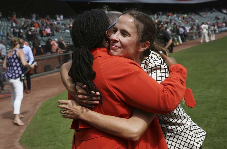 Tomiquia Moss of Hamilton Families embraces Kristen Berlacher of Airbnb, which has partnered with the Giants to give $300,000 to help Moss' program. Photo: Santiago Mejia / Santiago Mejia / The Chronicle / ONLINE_YES
