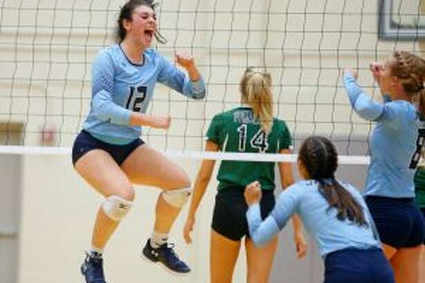 Johnson's Julia Deais celebrates a point during the Jaguars' District 26-6A match vs. Reagan. Photo by Ron Cortes/For the Express-News