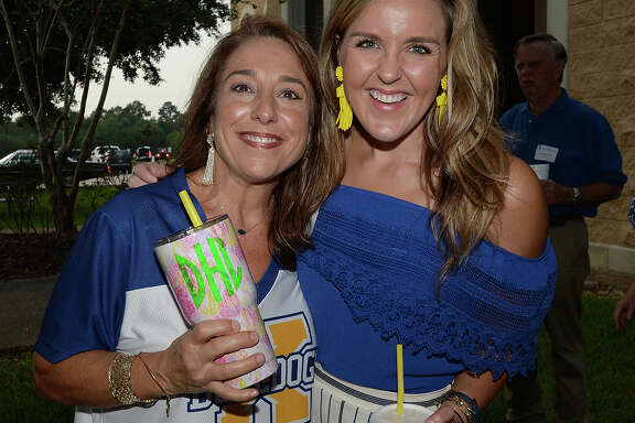 Denise Henke and Haylee Faggard were at Monsignor Kelly High School's homecoming pre-game tailgating party  Photo taken Friday, September 22, 2017 Kim Brent/The Enterprise