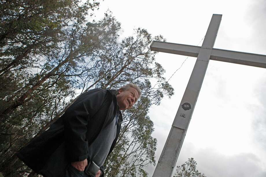 Larry Hicok of the East Bay Atheists wants the city of Albany to remove the cross on Albany Hill because it is a religious symbol. The Lions Club says it has an easement for the property. Photo: Franchon Smith, The Chronicle