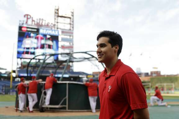 In this Wednesday, Sept. 20, 2017 photo, Philadelphia Phillies' team translator Diego Ettedgui talks with fans before a baseball game against the Los Angeles Dodgers in Philadelphia. (AP Photo/Matt Slocum)