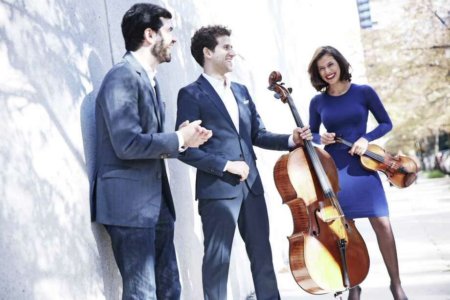 The Brown-Urioste-Canellakis Trio, from left, Michael Brown, piano; Nick Canellakis, cello; and Elena Urioste, violin. Photo: Photo Courtesy Of NHSO