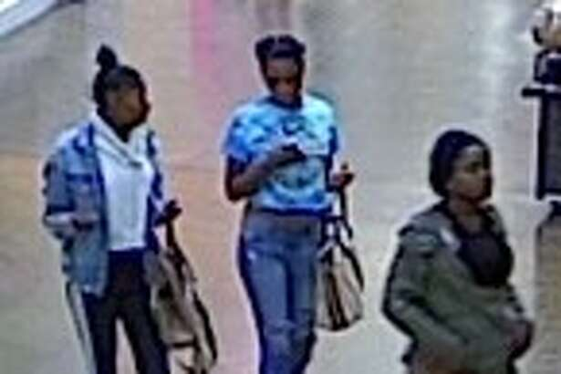 The three suspects are seen inside of the mall.