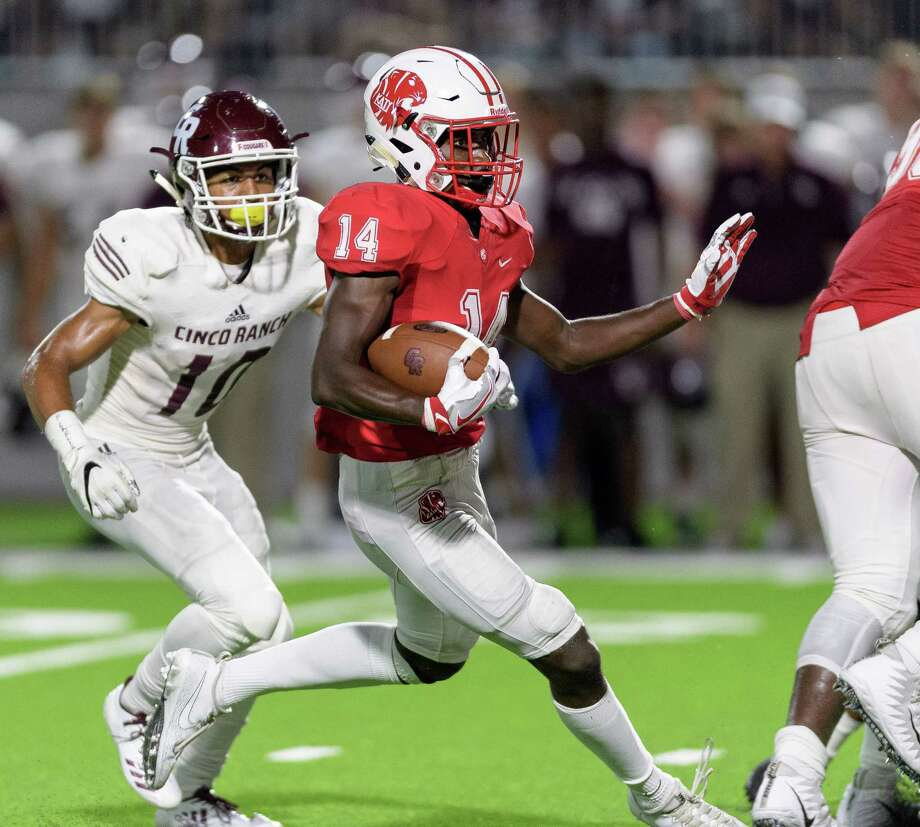 Izaiah Jordon (14) of the Katy Tigers returns an interception for a long gain in the second half against the Cinco Ranch Cougars in a high school football game on Friday, September 22, 2017 at Legacy Stadium in Katy Texas. Photo: Wilf Thorne / © 2017 Houston Chronicle