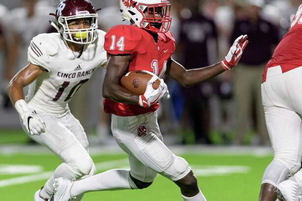 Izaiah Jordon (14) of the Katy Tigers returns an interception for a long gain in the second half against the Cinco Ranch Cougars in a high school football game on Friday, September 22, 2017 at Legacy Stadium in Katy Texas.