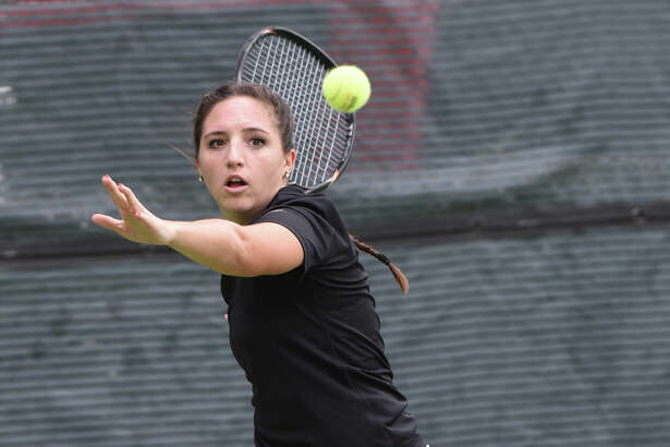 Macarena Sedano completes in mixed doubles during the Southwest Oilman's Tennis Tournament Sept. 23, 2017, at Midland Country Club. James Durbin/Reporter-Telegram