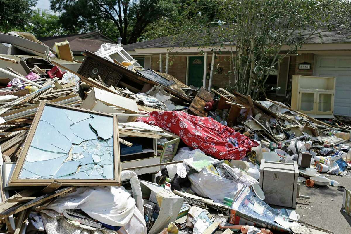 Debris outside a home at 5651 Ludington Dr. that Patricia Noren rented in the Westbury neighborhood for 12 years shown Saturday, Sept. 23, 2017, in Houston.