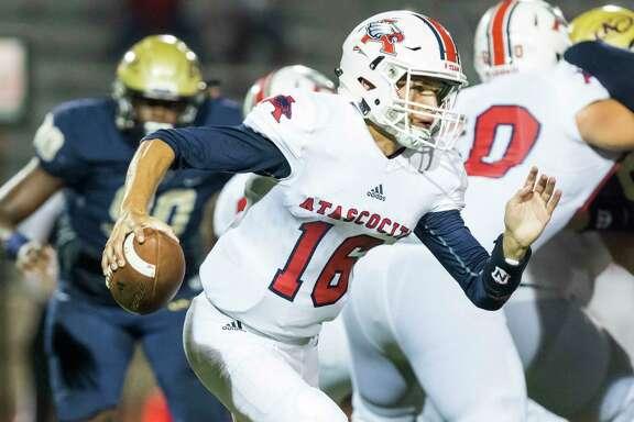 Atascocita quarterback Ethan Garrow (16) scrambles away from pressure for a short gain in a high school football game at Klein Memorial Stadium on Thursday, Sept. 21, 2017, in Klein, Texas. (Joe Buvid / For the Chronicle)