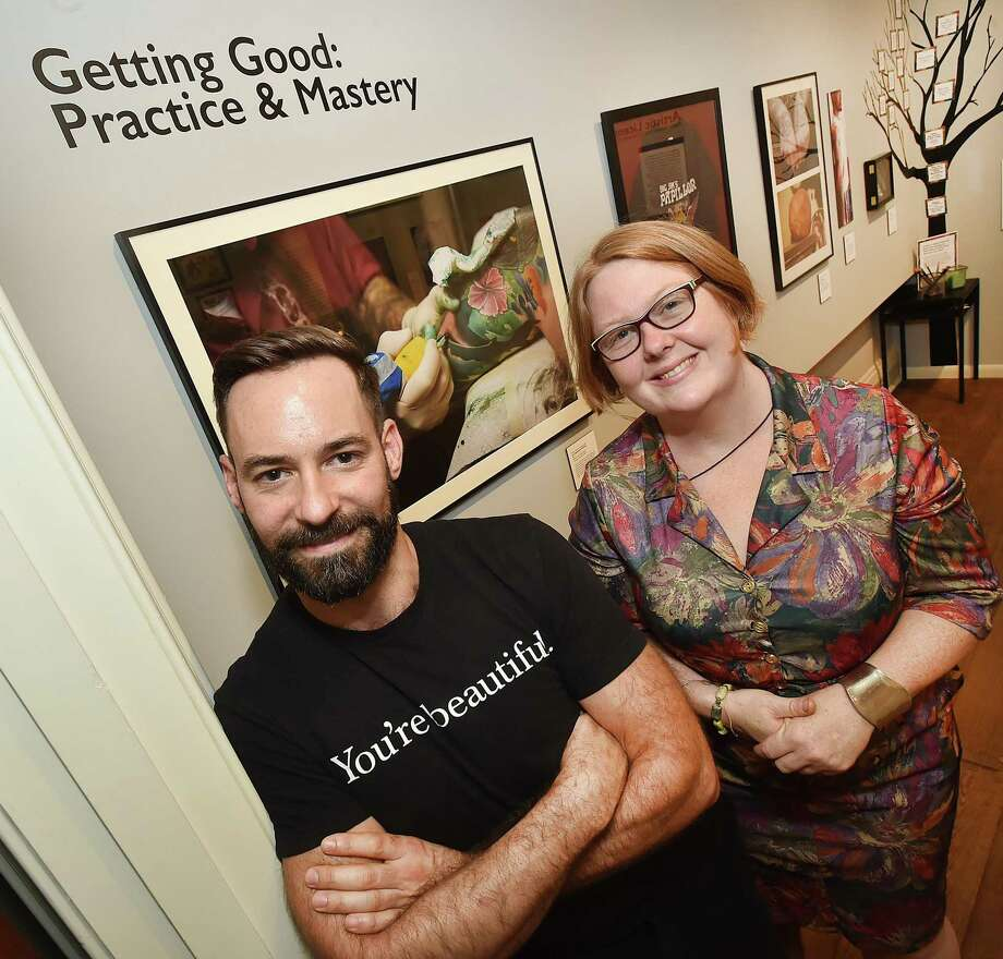 "Photojournalist Corey Hudson and guest curator Elinor Slomba photographed, Friday, September 22, 2017, at the exhibit entitled, ""Old School Ink"" at the New Haven Museum at 114 Whitney Avenue. The exhibit runs from September 23, 2017- March 19, 2018. (Catherine Avalone/Hearst Connecticut Media) Photo: Catherine Avalone / Hearst Connecticut Media / New Haven Register"