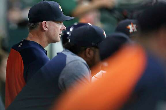 Houston Astros manager A.J. Hinch (14) in the dugout during the sixth inning of an MLB baseball game at Minute Maid Park, Saturday, Sept. 23, 2017, in Houston.