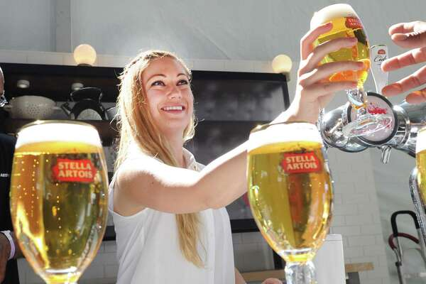 Bartender, Camille Reicherter, served Stella Artois from tap during the Greenwich Wine + Food Festival at Roger Sherman Baldwin Park in Greenwich, Conn., Saturday, Sept. 23, 2017. Proceeds of the festival, attended by several celebrity chefs and food authors, now in its seventh year in Greenwich, will benefit the Mario Batali Foundation, Friends of James Beard Benefits and the town's  Parks and Recreation Foundation.