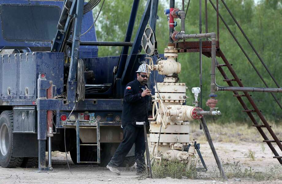 Ricky Gutierrez of the W.W. Wireline Company works on a Hilcorp wellhead Friday August 4, 2017 in Zapata County, Texas. W.W. Wireline contracts with Hilcorp Energy. Hilcorp, founded in 1989, is one of the largest privately-held oil and natural gas exploration and production companies in the United States and is the largest oil producer in Louisiana. Natural gas production has been on the rise and there is potential that gas will find a market in the Port of Corpus Christi and by pipeline to Mexico which needs natural gas for electric generation. Photo: John Davenport, STAFF / ©John Davenport/San Antonio Express-News