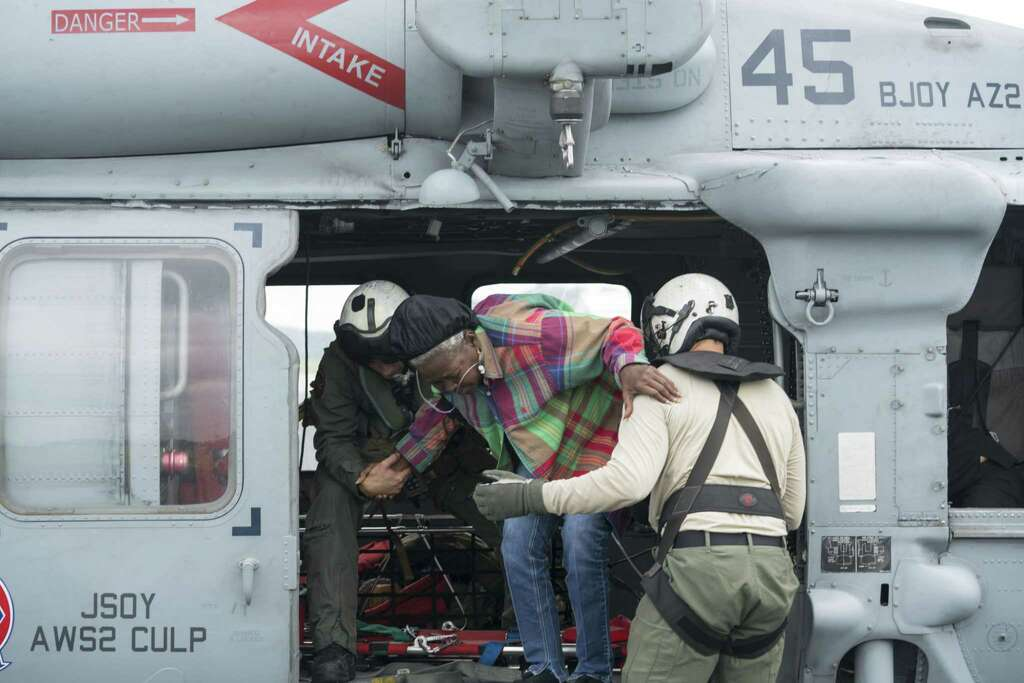 U.S. Navy crewmen assist with a medical evacuation during Hurricane Harvey relief efforts in Jasper, Texas.