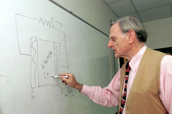 John B. Goodenough draws a diagram of a battery on the board in his office at the University of Texas at Austin.