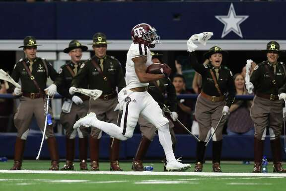 ARLINGTON, TX - SEPTEMBER 23:  Christian Kirk #3 of the Texas A&M Aggies runs for a 100 yard kickoff return for a touchdown in the fourth quarter against the Arkansas Razorbacks at AT&T Stadium on September 23, 2017 in Arlington, Texas.