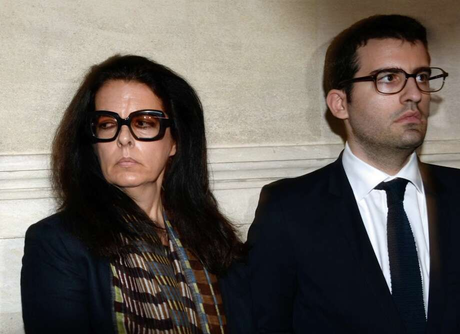 Françoise Bettencourt-Meyers (L), her son Nicolas, prepare to speak to journalists on May 28, 2015 at the Bordeaux courthouse, southwestern France, after the deliberations of the tribunal in his trial for allegedly exploiting France's richest woman Liliane Bettencourt.>>The richest people in every state. Photo: JEAN-PIERRE MULLER/AFP/Getty Images