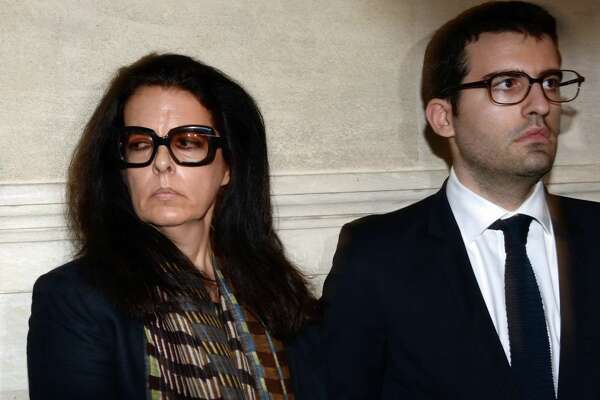 Françoise Bettencourt-Meyers (L), daughter of France's richest woman Liliane Bettencourt, and his son Nicolas, prepare to speak to journalists on May 28, 2015 at the Bordeaux courthouse, southwestern France, after the deliberations of the tribunal in his trial for allegedly exploiting France's richest woman Liliane Bettencourt. 10 members of Bettencourt's entourage are accused of taking advantage of the 92-year-old billionaire's growing mental fragility in an explosive legal and political drama.AFP PHOTO / JEAN-PIERRE MULLER / AFP PHOTO / JEAN-PIERRE MULLER        (Photo credit should read JEAN-PIERRE MULLER/AFP/Getty Images)
