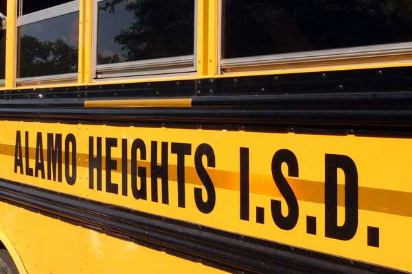 A school bus leaves Alamo Heights Junior High School in this 2004 file photo. A former coach at the school has lost her sexual harassment discrimination lawsuit against Alamo Heights ISD because she couldn't prove that the female co-worker who allegedly harassed her was gay. (Robert McLeroy/Staff)