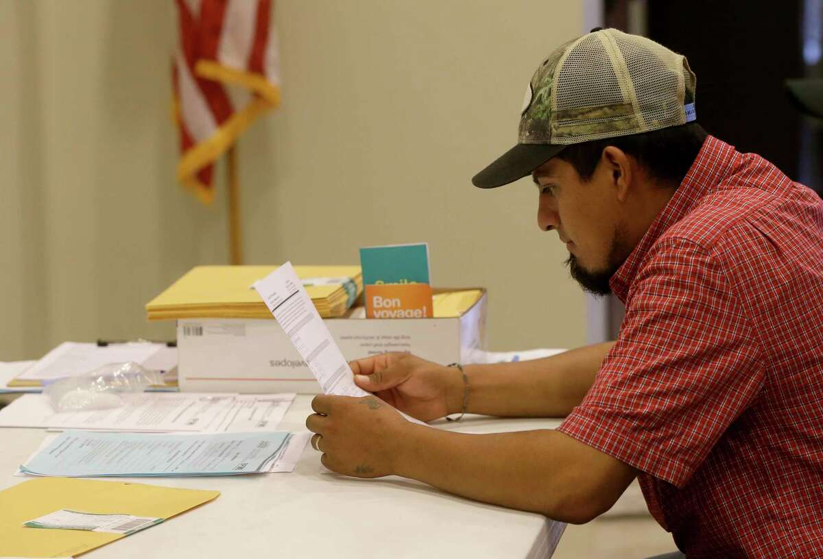 Erik Villalpando looks over his DACA renewal paperwork during a DACA Renewal Workshop hosted by Justice for our Neighbors Houston (JFON) and Boat People SOS (BPSOS) held at St. Luke?•s Gethsemane Campus, 6856 Bellaire Blvd., Saturday, Sept. 23, 2017, in Houston.