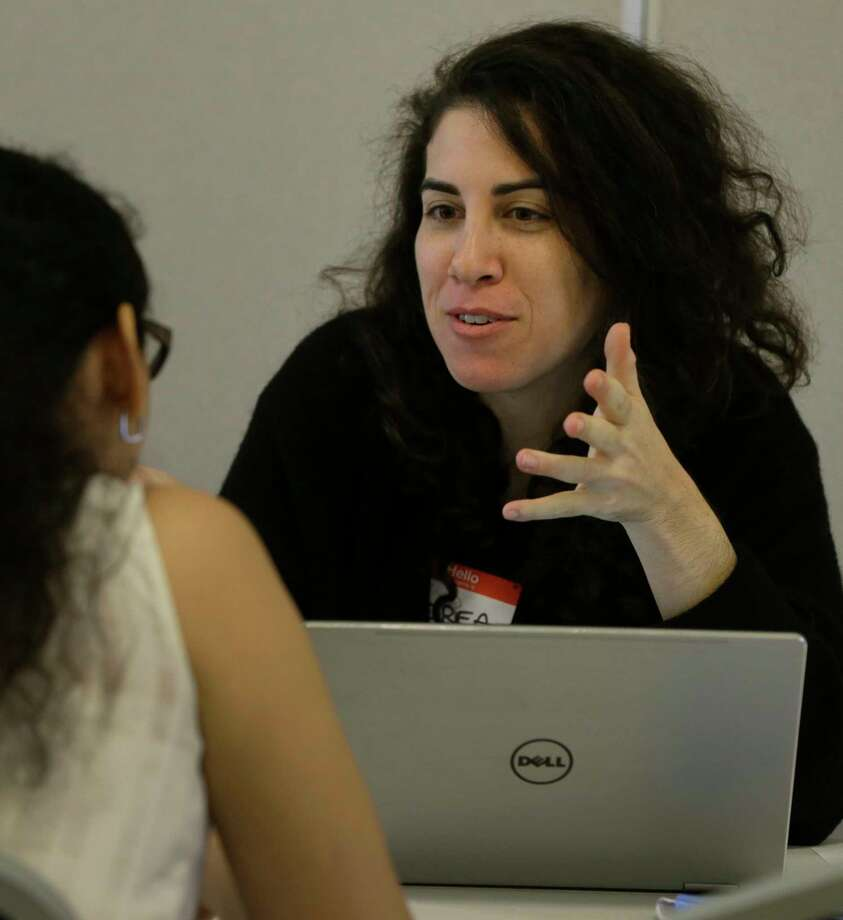 Andrea Guttin, legal director at Houston Immigration Legal Services, right, talks with Jessica Zarate, of Boat People SOS, left, during a DACA Renewal Workshop hosted by Justice for our Neighbors Houston (JFON) and Boat People SOS (BPSOS) held at St. LukeÕs Gethsemane Campus, 6856 Bellaire Blvd., Saturday, Sept. 23, 2017, in Houston. Photo: Melissa Phillip, Houston Chronicle / © 2017 Houston Chronicle