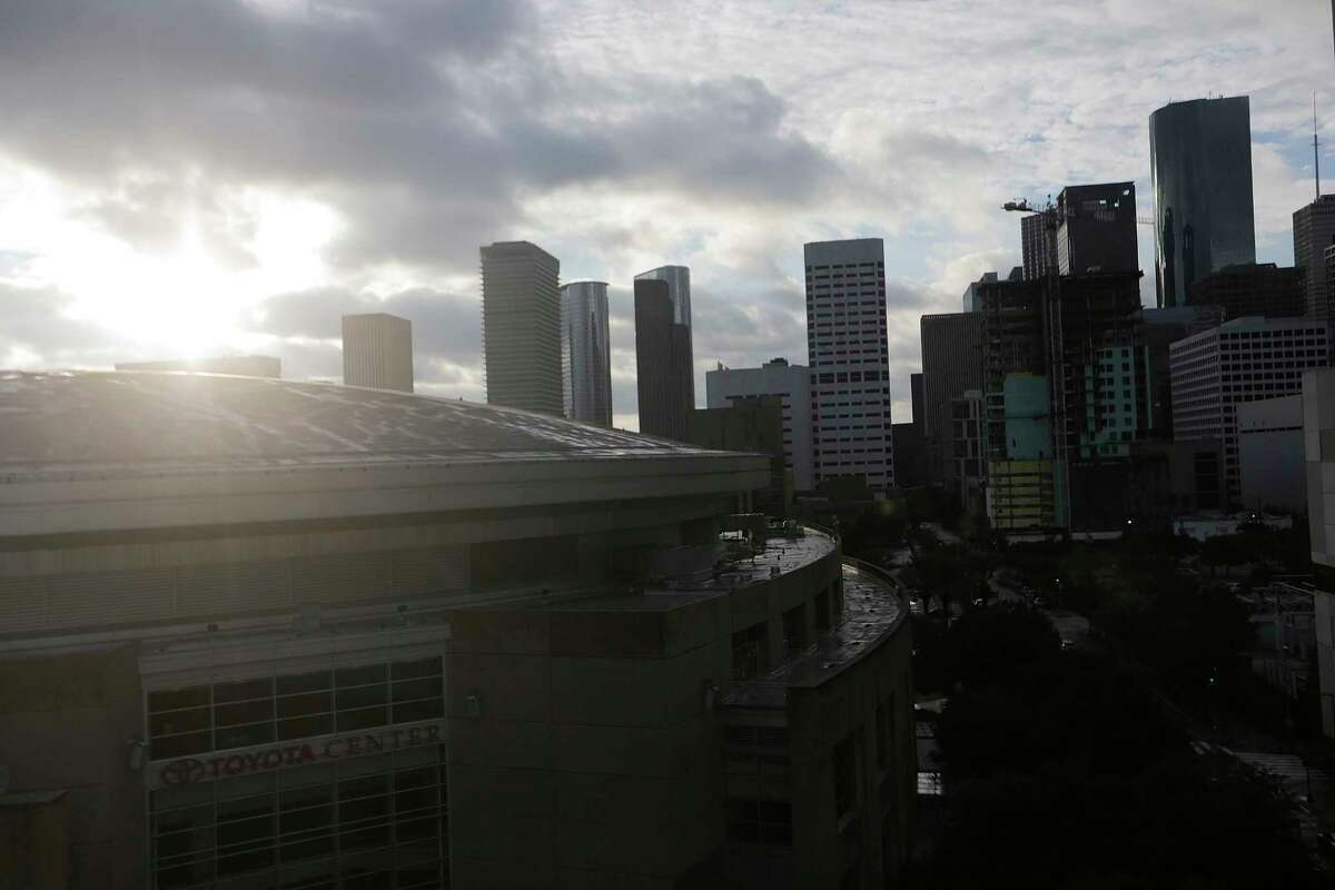 The sun peaks out over the Toyota Center and Houston's skyline as Tropical Storm Harvey makes its way out of Houston on Tuesday, Aug. 29, 2017. ( Elizabeth Conley / Houston Chronicle )