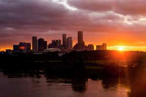 The sun sets over the Houston skyline as Tropical Storm Harvey moves out of the region Tuesday, Aug. 29, 2017. ( Michael Ciaglo / Houston Chronicle)
