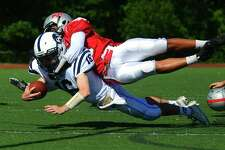 Fairfield Warde's Jeff Seganos Jr. tackles Wilton's Brian Calabrese keeping him from reaching the endzone during football action in Fairfield, Conn. on Saturday Sept. 23, 2017.