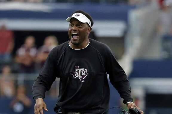 Texas A&M head coach Kevin Sumlin shouts instructions to his team late in the second half of an NCAA college football game against Arkansas on Saturday, Sept. 23, 2017, in Arlington, Texas. (AP Photo/Tony Gutierrez)