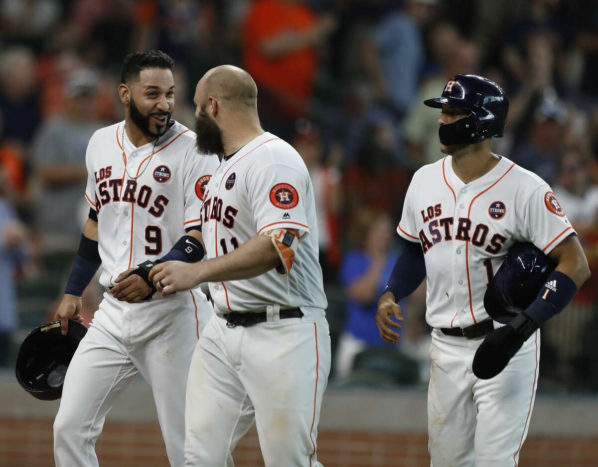Houston Astros Evan Gattis (11) celebrates his three-run home run with Marwin Gonzalez (9) and Carlos Correa (1) during the fifth inning of an MLB baseball game at Minute Maid Park, Saturday, Sept. 23, 2017, in Houston. ( Karen Warren / Houston Chronicle )