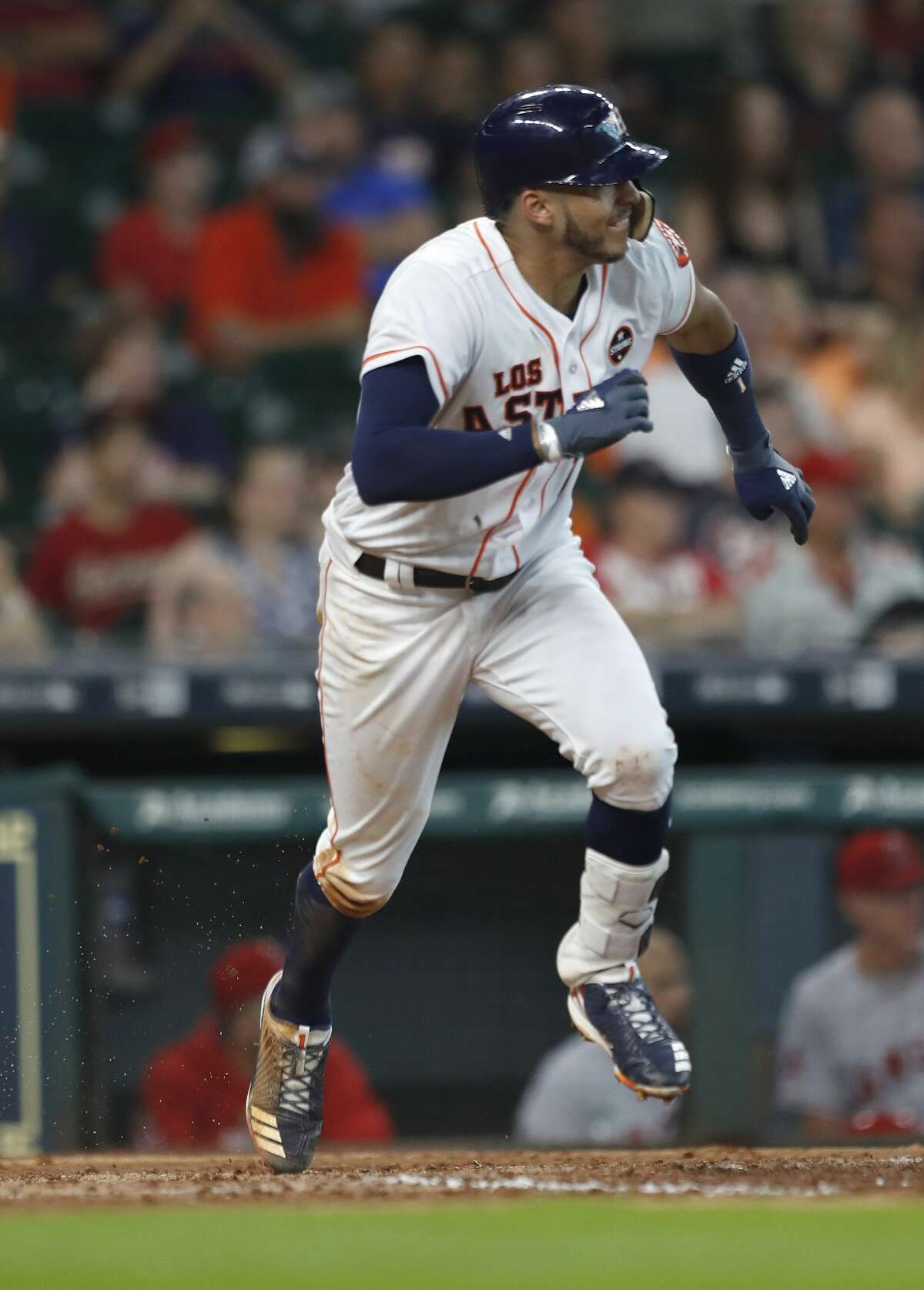 Houston Astros Carlos Correa (1) runs up the line on his RBI single during the seventh inning of an MLB baseball game at Minute Maid Park, Saturday, Sept. 23, 2017, in Houston. ( Karen Warren / Houston Chronicle )