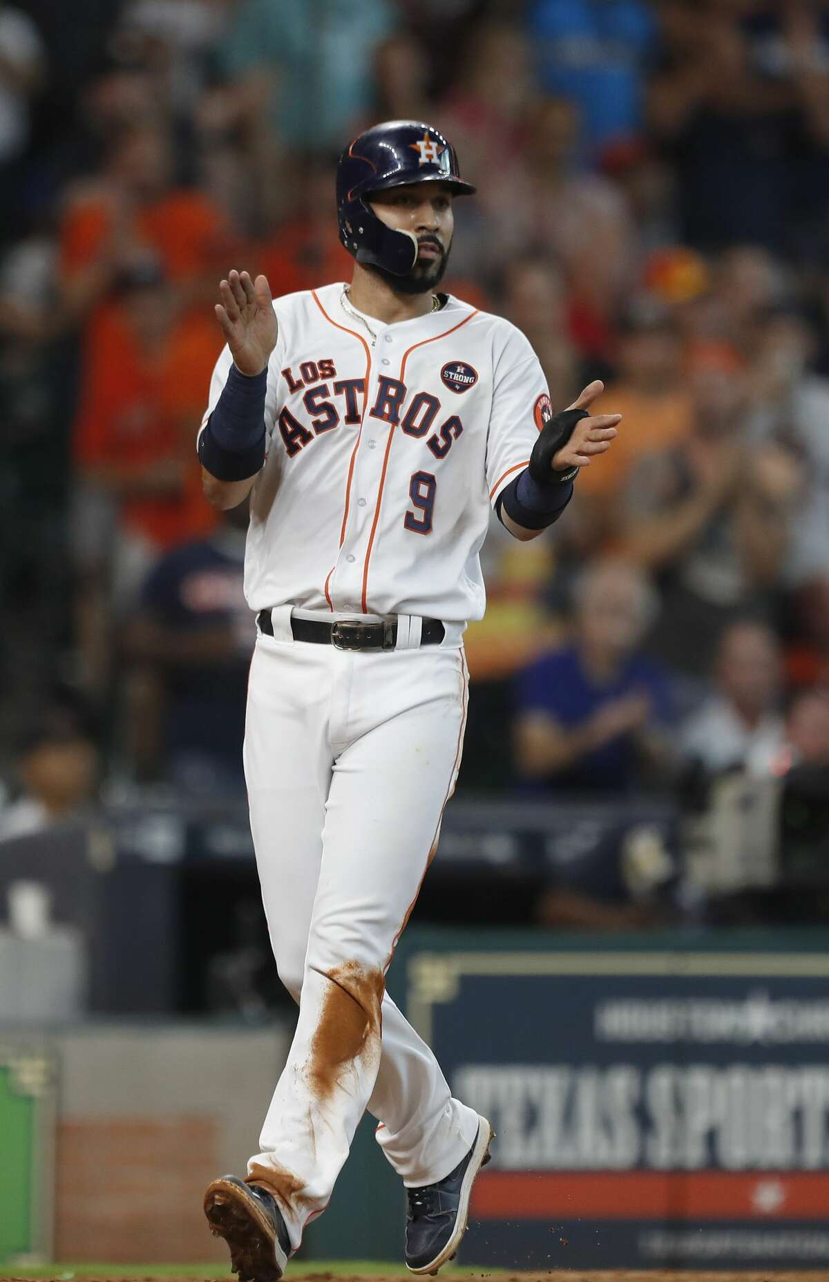 Houston Astros Marwin Gonzalez (9) claps for Carlos Correa as he scored a run on his RBI single during the seventh inning of an MLB baseball game at Minute Maid Park, Saturday, Sept. 23, 2017, in Houston. ( Karen Warren / Houston Chronicle )