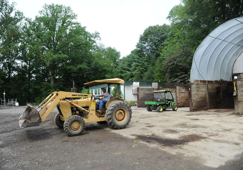 A loader drives past mulch piles and a landscaping building at Sam Bridge Nursery and Greenhouses in Greenwich on Aug. 8. Photo: Tyler Sizemore / Hearst Connecticut Media / Greenwich Time